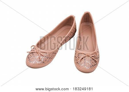 Pair of beige ladies' flat shoes isolated on white background.