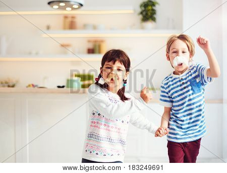 Excited Kids With Mustaches Having Fun On Kitchen At Home