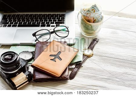 Travel And Wanderlust Concept, Planning Summer Vacation, Space For Text. Jar With Money Map Compass