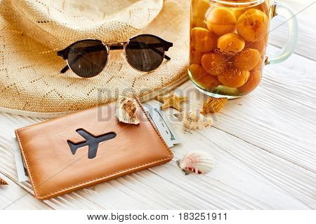 Summer Vacation Concept. Yellow Cocktail Juice With Apricot, Hat, Sunglasses Plane And Shells And Pa