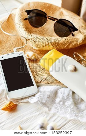 Summer Travel Vacation Concept, Space For Text. Phone With Empty Screen And Sunglasses And Sunscreen