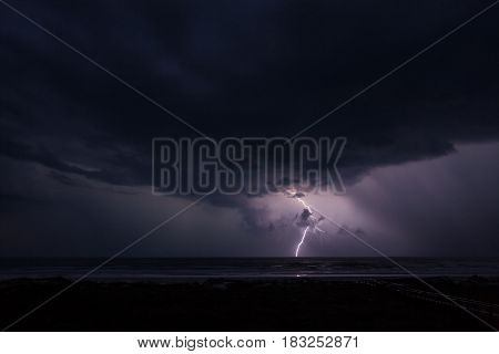 Lightning and Storm over the Ocean at Night