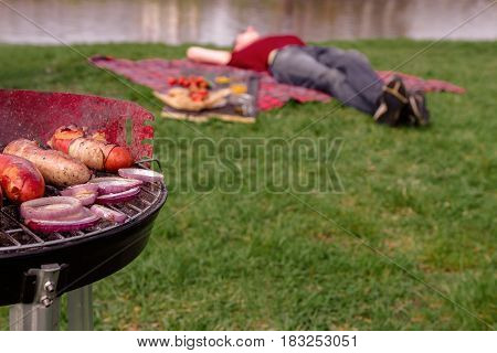 Man Relaxing In The Park And Having Barbecue Lunch. Grill With Various Delicious Barbecue Outdoor, S