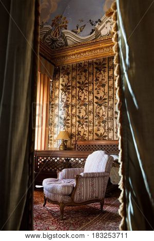 VIGNANELLO, ITALY. November 17, 2015: Room nineteenth century inside the Castello (castle) Ruspoli, 16th-century castle, in the town of Vignanello, Lazio, Italy. Bedroom vintage. Curtains in the foreground.