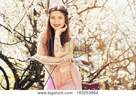 Beauty Portrait. Smiling Beautiful And Young Long-haired Girl In Pink Dress Standing With Retro Bike