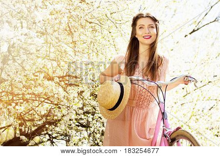 Flowers Around You. Portrait Of Smiling Young And Beautiful Long-haired Girl In Pink Dress Standing