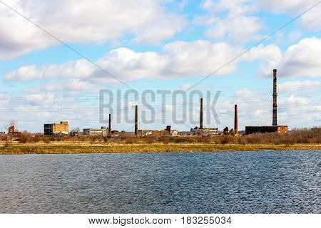 Old Abandoned chemical factory with chimneys on the banks of the river 3