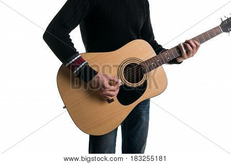 A Guitarist In Jeans And A Black Sweater, Plays An Acoustic Guitar With A Slider, In The Center Of T