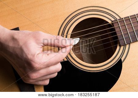 The Guitarist Plays The Acoustic Guitar Close-up. Horizontal Frame