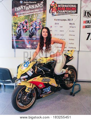 St. Petersburg Russia - 15 April, The girl on motobike,15 April, 2017. International Motor Show IMIS-2017 in Expoforurum. Models on motorcycles presented at the motor show.