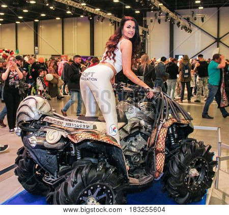 St. Petersburg Russia - 15 April, A fashion model on an ATV,15 April, 2017. International Motor Show IMIS-2017 in Expoforurum. Models on motorcycles presented at the motor show.