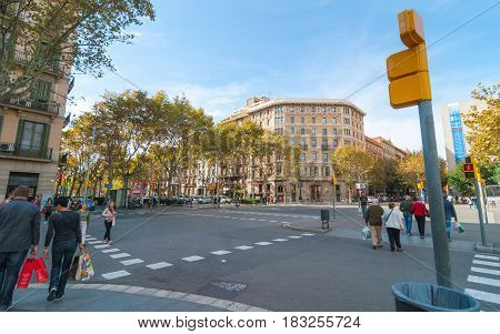 Barcelona, Spain - November 9th, 2013:  People walking in streets, cross at a corner.   Normal day of visitor pedestrian traffic despite down-turning economies.  People out & about on November afternoon.
