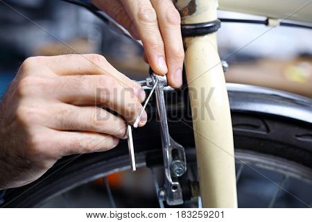 The man exchanges the brake pads on the bike