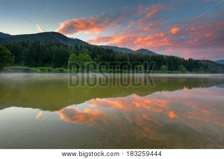 Summer Sunrise on Moutnains Lake, colorful clouds and reflection, Freizeitsee Zenz, Austria, Europe