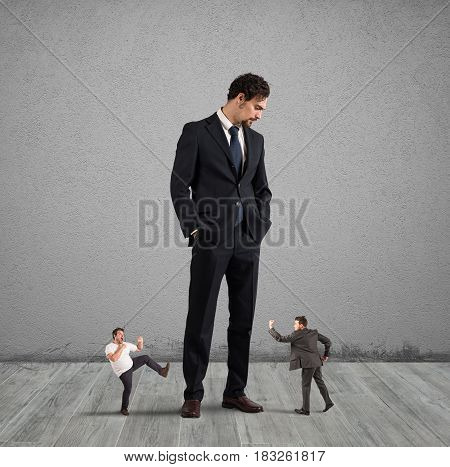 Big businessman looking small businessmen. Employees who want to rebel at their boss