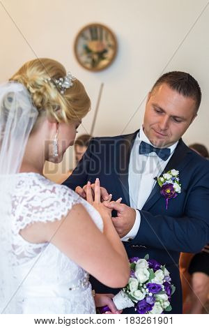 Man and woman in a registry office during the ceremony in Lviv, Ukraine