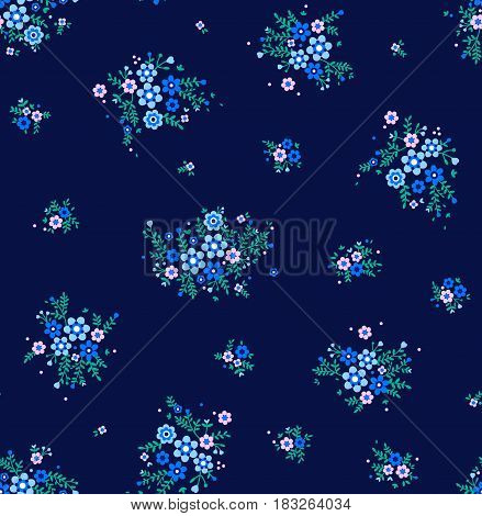 Floral pattern. Pretty flowers on dark blue backgroung. Printing with Small-scale light blue flowers. Ditsy print. Seamless vector texture. Spring bouquet.