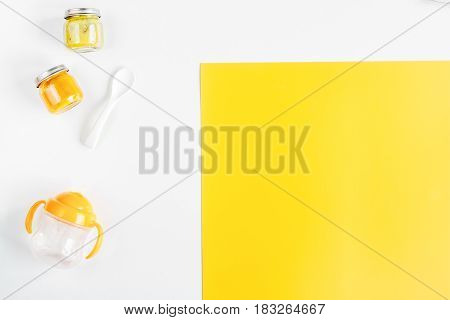 children flat lay with toys on white and yellow colorful desk background top view space for text