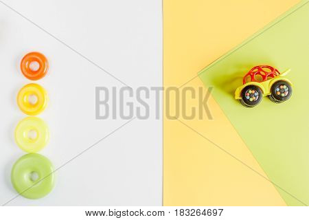 kids desk design with toys on yellow white background top view space for text