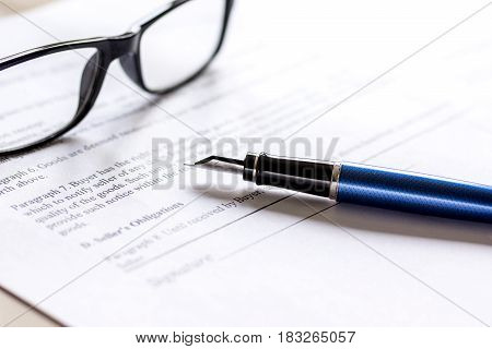 workspace with document, glasses and feather pen for sign for businessman day