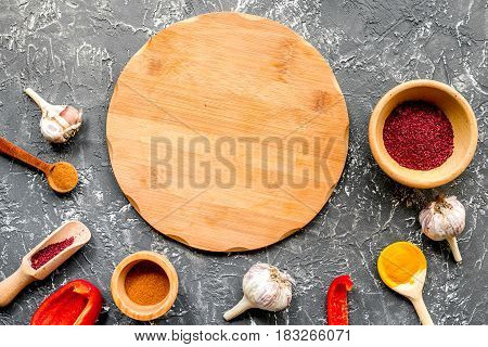 composition of cooking tools and spices on dark kitchen table background top view
