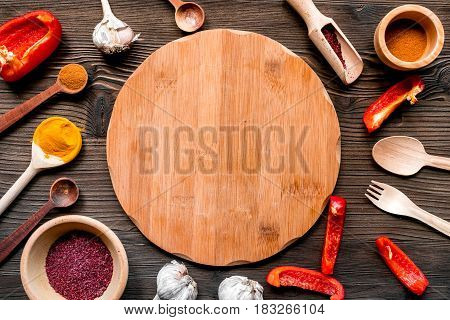 cooking tools, vegetables and spices in restaurant concept on wooden table background top view