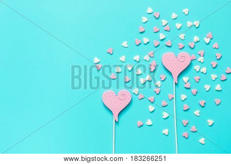 Delicious sugar lollipops and candys on blue background top view space for text