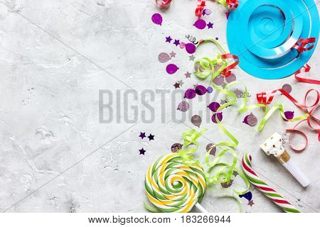 birthday party colorful frame for mock-upwith confetti on stone background top view