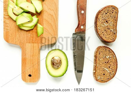fresh sliced avocado for homemade sandwiches on white kitchen table background top view