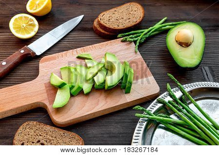 fitness lunch with healthy avocado sandwich on wooden kitchen table background