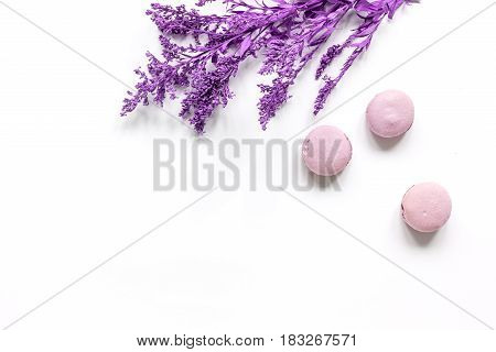modern spring design in pastel color with macaroons and flowers on white background top view mock up