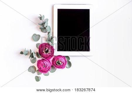 spring with bright flowers mock up and tablet on woman white desk background top view