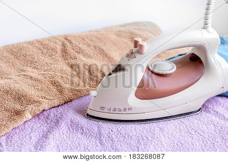 ironing pile of colorful towels in housekeeping concept on fabric background