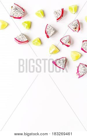 exotic fruits pattern with kiwi and pitaya isolated on white background top view mockup