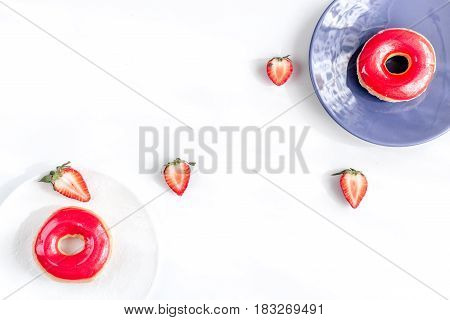 tasty lunch with colorful donuts and strawberry on white table background top view mock up