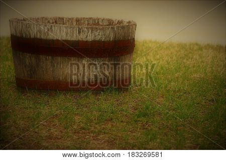 wood barrel  rust  grass rings green  planter