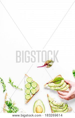 triangle sandwiches set on white table background top view space for text
