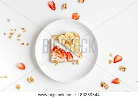triangle sandwiches set in plates on white table background top view
