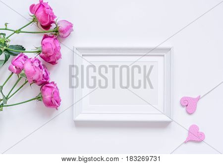 present design with peony bouquet and white frame on white background top view mock up