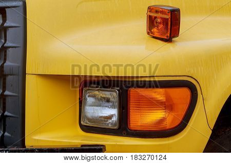 Front end of a semi truck while parked yelow truck