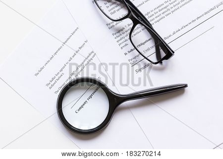 white workspace with document for sign and glasses for businessman day top view