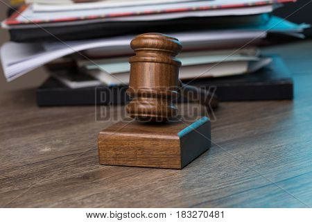 Wooden table with hammer judge