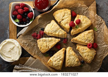 Freshly baked homemade scones with cream cheese and fruits