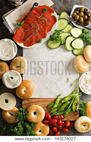 Big breakfast platter with cream cheese, bagels, smoked salmon and vegetables with copyspace