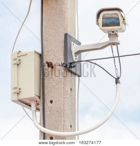 CCTV Surveillance security camera on exterior electric pole.