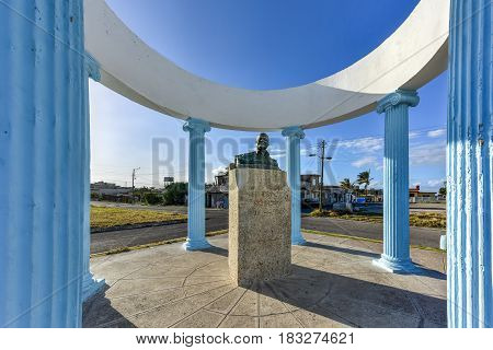 Havana, Cuba - Jan 15, 2017: Bust to Ernest Hemingway in Havana Cuba. He is remembered by Cojimar with a small gazebo that encircles a commemorative bust sculpted from the melted down propellers donated by local fishermen.
