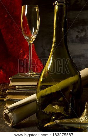 Vintage Still Life with a Wine Bottle and Old Books