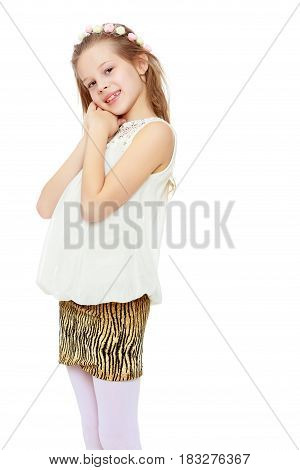 Beautiful little long-haired Caucasian girl posing in Studio.Girl holding the hands of a person.Isolated on white background.