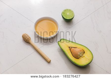 Healthy Food Concept. Fresh Organic Avocado With Honey On Table