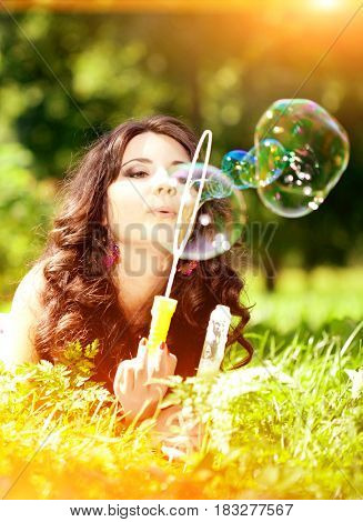 Woman and soap bubbles in park